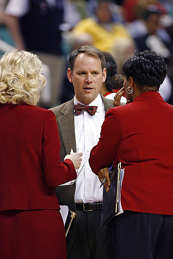 Richard Barron (center) was named head coach of the UMaine women's basketball team Monday. Here, Barron talks with NC State head coach Kellie Harper and assistant coach Stephanie McCormick during a past NC State game.