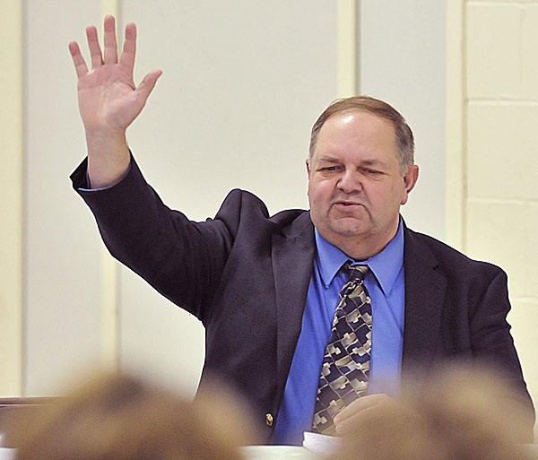 Appointed interim town manager for Newburgh , Waren Hatch, introduces himself at a town meeting in the former Newburgh elementary school Monday.