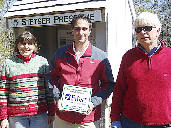 The First Bancorp is the first business to adopt an Sheepscot Valley Conservation Association preserve. Pictured at the Stetser Preserve in Jefferson are SVCA Lands Director Tish Carr, with Gary Stone of First Advisors, the investment management division of The First, and the preserve's volunteer steward, Peter DuBois.