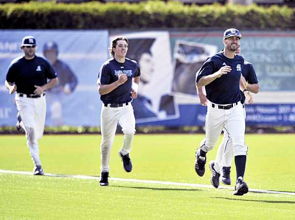 UMaine baseball's Joey Martin (right) leads some of the players in a final sprint in practice Thursday in Orono.