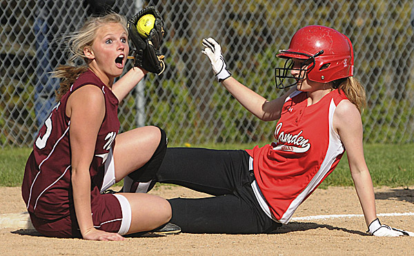 Nokomis third baseman Taylor Lovley reacts to a safe call after tagging Camden Hills runner Abby White during third-inning action at Rockport Friday. Camden Hills won 10-0.