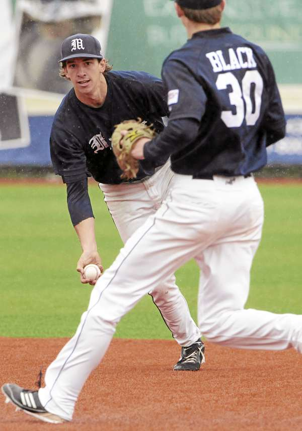 UMaine shortstop Michael Fransoso, left, tosses the ball to second baseman Troy Black so he can force out Hartford's Mike Thatcher out at second base during seventh-inning action at Orono on Sunday May 15, 20112.