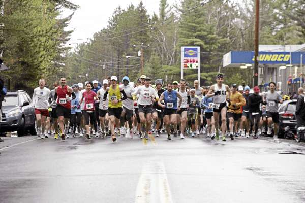Runners take off from the starting line in the 29th Sugarloaf Marathon Sunday.