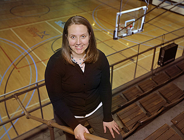 Amy Vachon poses for a photo at the University of Maine's Memorial Gym in Orono Monday. The former Cony High and UMaine star has been named an assistant coach to the UMaine women's basketball team.
