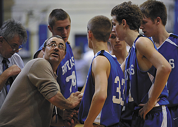 Jonesport-Beals coach Vinnie MacLean checks the scoreboard as he huddles with his team during a timeout during the Eastern Maine Class D final on Feb. 26 at the Bangor Auditorium. MacLean's coaching contract has not been renewed by Jonesport-Beals.