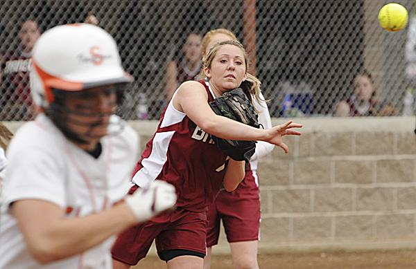 Bangor pitcher Taylor Lewis throws out Skowhegan runner Shelby Obert during third-inning action in Bangor Friday. Skowhegan won 5-0.