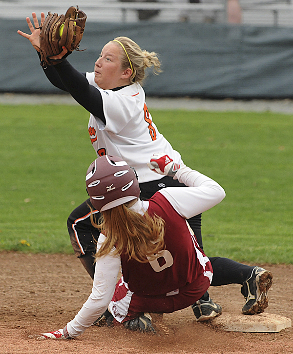 Skowhegan's Mary Barker makes the catch and forces out Bangor's Jade Baumrind at second base during the third inning at Bangor on Friday, May 20, 2011.