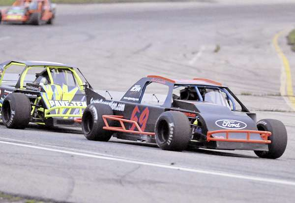 Reid Lanpher, in the No. 59 car in the Modifieds division, races to victory Saturday at Speedway 95 in Bangor.