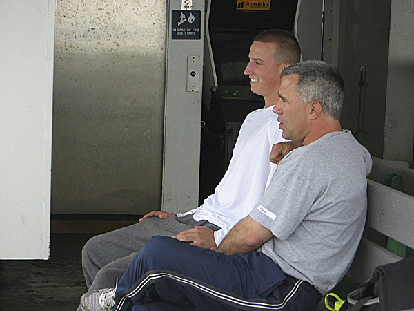 University of Maine pitcher Keith Bilodeau (left) and Black Bears head coach Steve Trimper chat Tuesday while riding on the Long Island Ferry from Bridgeport, Conn., to Port Jefferson, N.Y. UMaine is playing in the America East Baseball Championship. BDN photo by Pete Warner