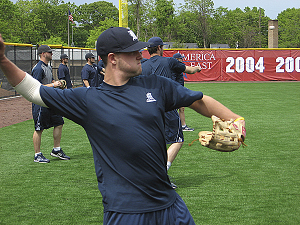 Freshman Alex Calbick plays catch with a teammate Tuesday afternoon during the University of Maine's practice prior to the America East baseball tournament, which begins Wednesday in Stony Brook, N.Y. BDN photo by Pete Warner