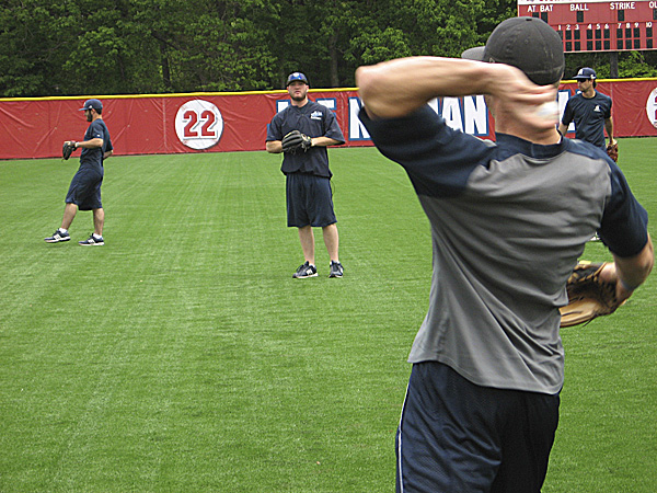 Taylor Lewis (foreground) of the University of Maine plays catch with teammate Robbie Trask during Tuesday's practice session at Joe Nathan Field in Stony Brook, N.Y. BDN photo by Pete Warner