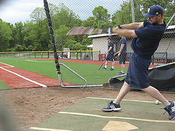 Senior outfielder Joey Martin takes a cut in the batting cage Tuesday during the University of Maine baseball team's workout at Joe Nathan Field on the campus of Stony Brook University in Stony Brook, N.Y. BDN photo by Pete Warner