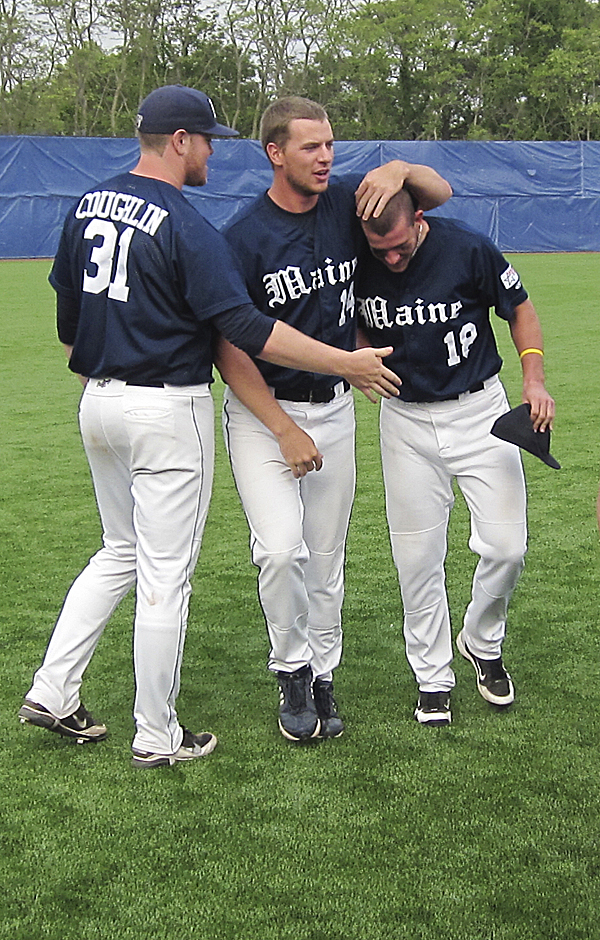 Alex Calbick of the University of Maine is congratulated by teammates A.J. Bazdanes (second left) and Shaun Coughlin on after his five RBIs helped the Black Bears earn an 8-1 victory over Stony Brook in the America East Baseball Championship.