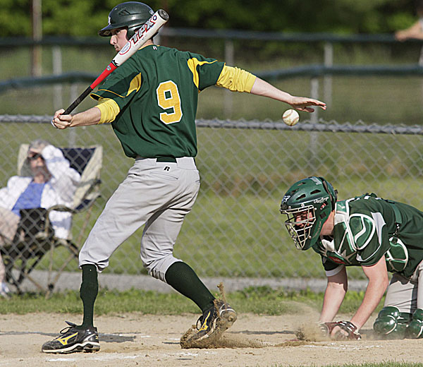 MDI's Kyle McKim (9) fouls off a pitch as Old Town catcher Andrew Richardson reacts during their game in Old Town Thursday.