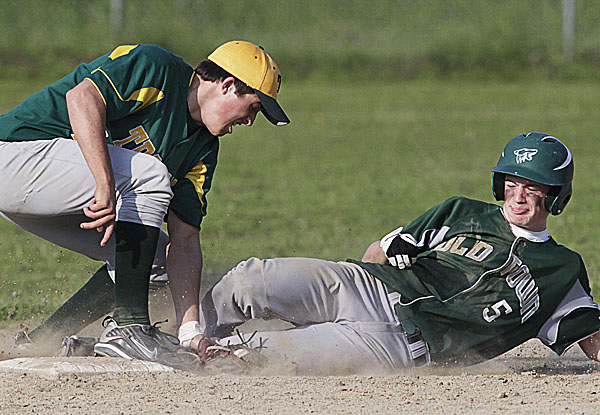 Old Town's Dan Gastia (5) is tagged out at second on a steal attempt by MDI shortstop Nick Shaw (12) in the fourth inning of their game in Old Town, Thursay, May 26, 2011.