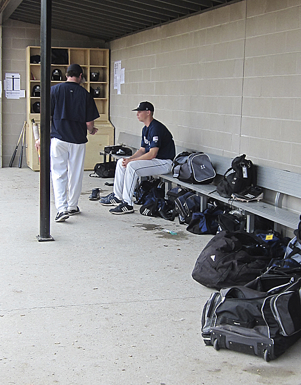 Jeff Gibbs of the University of Maine takes some quiet time in the shade of the first base dugout Thursday afternoon as he waits to take the mound against Stony Brook in the second round of the America East baseball tournament at Stony Brook, N.Y.