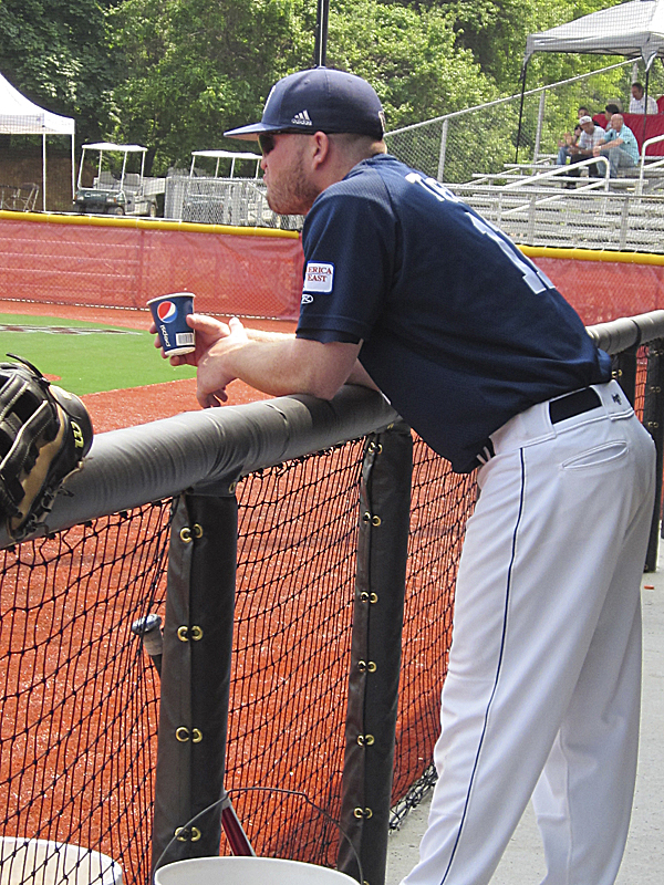 Robbie Trask of the University of Maine leans on the dugout railing as the Black Bears take infield practice prior to Thursday's game against StonY Brook in the America East baseball tournament in Stony Brook, N.Y.