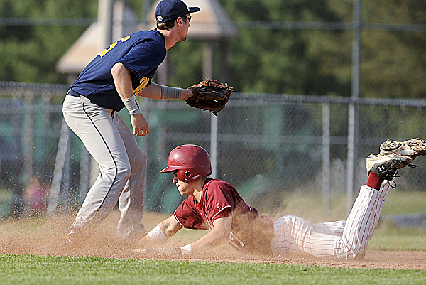 Bangor's Nic Cota slides in safely with a two-run triple while Mt. Blue third baseman Blake Hart waits for the throw in the third inning Friday at Mansfield Stadium in Bangor. Bangor defeated Mt. Blue 3-1.