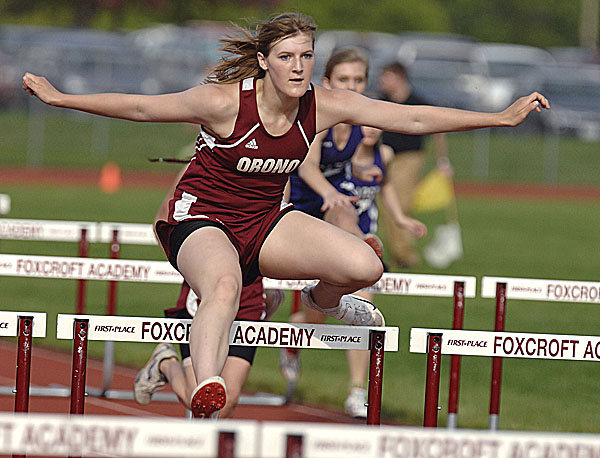 Orono's Shelby Wheeler flies to victory in the 100m hurdles Friday in the PVC Class C Championships at Foxcroft Academy.