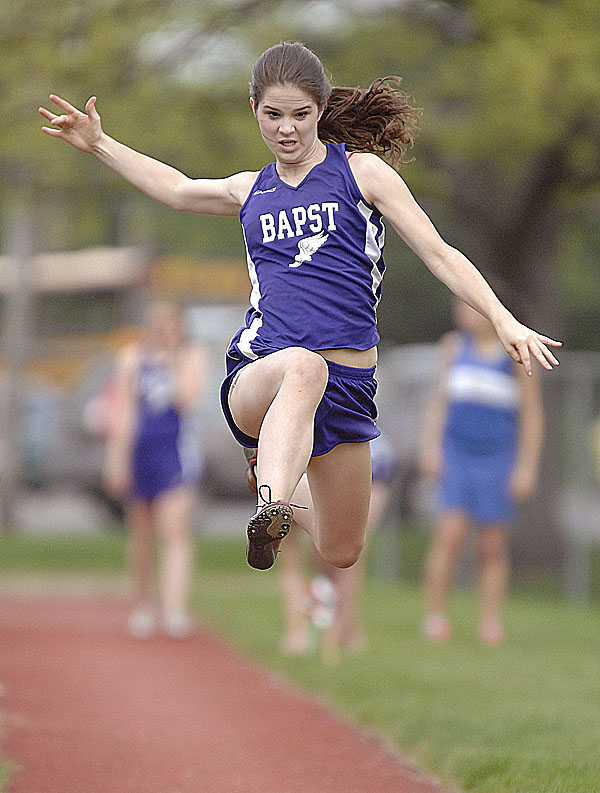 John Bapst's Kristin Weed competes in the triple jump final in Dover-Foxcroft Friday during the PVC Class C championships.