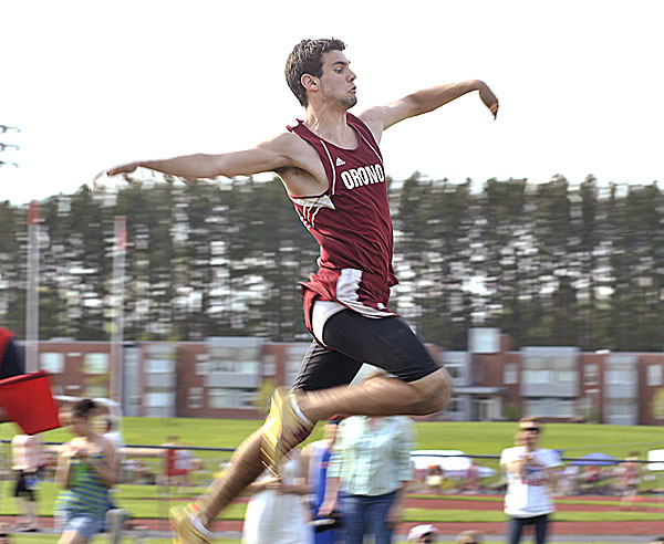 Orono's Phillip Holmes competes in the triple-jump finals in Dover-Foxcroft Friday during the PVC Class C championships.