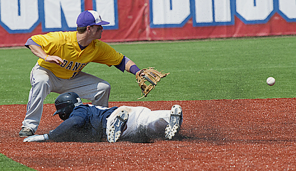 Maine's Taylor Lewis slides in safely with a first-inning double ahead of the throw to Albany's Jeff Welsh Friday.