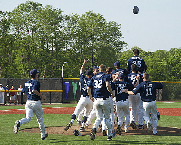 Maine players celebrate their 10-1 win over Albany in the America East championship game Friday in Stony Brook, N.Y.