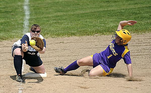 Bucksport's Sadie Wight slides safely into third base while Presque Isle third baseman Jess Dumais waits for the throw in the first inning of the first game of a doubleheader Monday in Bucksport. Wight doubled and went to third on the throw home. Bucksport swept the Wildcats 24-1 and 16-2.