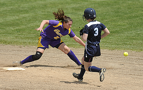 Presque Isle High School's Shea Brown (right) runs to second base as Bucksport shortstop Shelby Redman waits for the throw during the first inning of the first game of a doubleheader in Bucksport Monday.