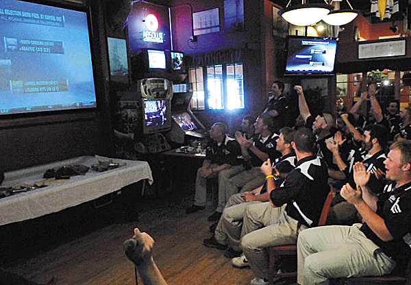 Members of the University of Maine baseball team react to the announcement on ESPN of their selection to the NCAA regional in Chapel Hill, N.C., against tourney host North Carolina. The team gathered at the Sea Dog restaurant in Bangor to watch the selection show.