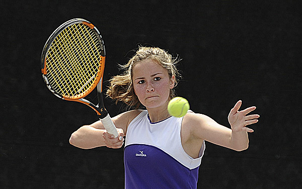 Ashley Woodside of Hampden Academy makes a return during her state singles Round of 16 match against Annie Criscione of Falmouth at Bates College in Lewiston Tuesday afternoon. Criscione won 6-2, 6-0.