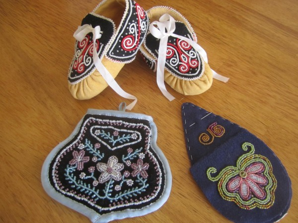 Some of Jennifer's beadwork, including a reproduction-in-progress of a beaded purse, based on a photograph