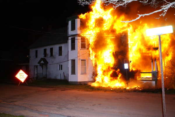 An apartment building at 467 Main St. in Norway burns early Monday morning. Todd Fickett, 19, has been arrested in connection with the fire. Residents escaped the fire safely, according to Norway Assistant Fire Chief Jim Tibbetts.