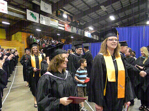 Northern Maine Community College students are congratulated by faculty and staff of the College as the exit commencement exercises at The Forum in Presque Isle on Saturday.