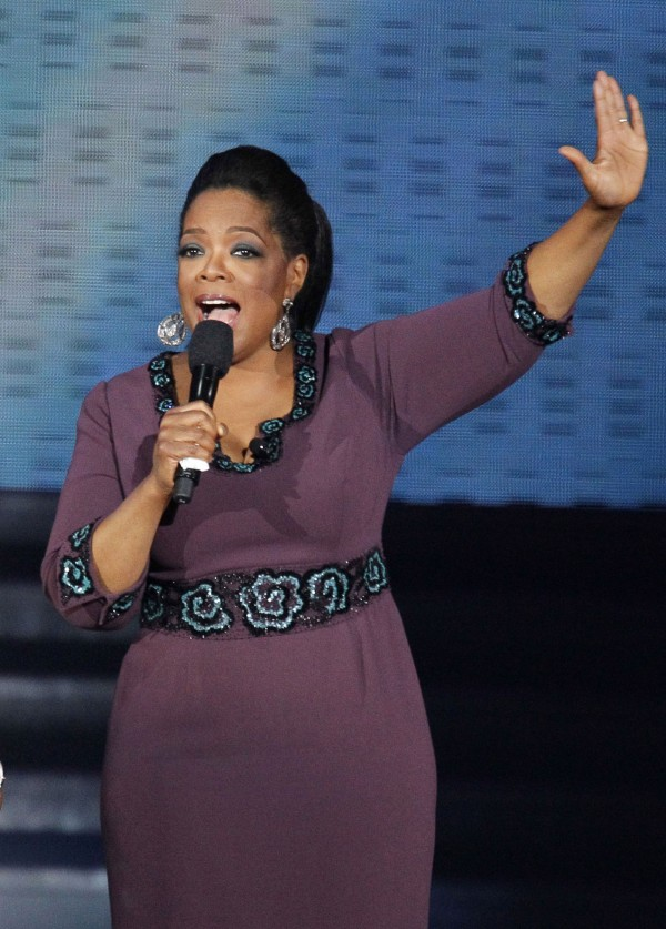 Aretha Franklin and Oprah Winfrey acknowledge fans during a star-studded double-taping of &quotSurprise Oprah! A Farewell Spectacular,&quot Tuesday, May 17, 2011, in Chicago. &quotThe Oprah Winfrey Show&quot is ending its run May 25, after 25 years, and millions of her fans around the globe are waiting to see how she will close out a show that spawned a media empire.