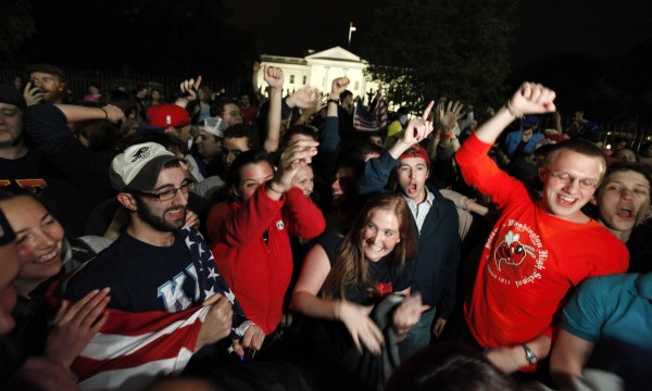 A crowd outside the White House in Washington, cheers Sunday, May 1, 2011, upon hearing the news that terrorist leader Osama bin Laden is dead.