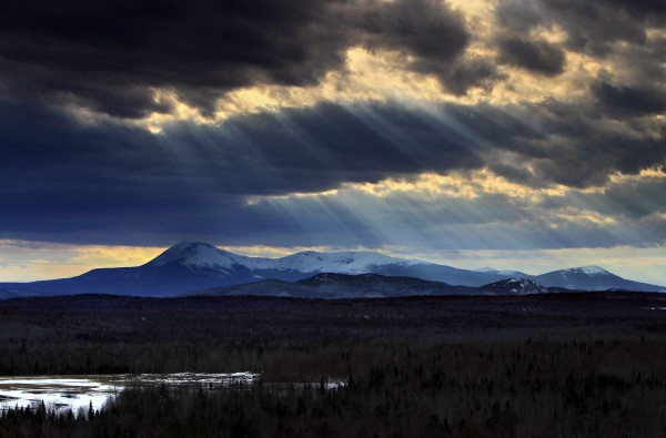 In this March 19, 2010 photo, sun rays filter through clouds over 5,267-foot Mount Katahdin in Maine's Baxter State Park. Last year, starting in March, more than 1400 hikers set off from Georgia's Springer Mountain with the goal of reaching the summit of Mount Katahdin, the northern terminus of the 2,100-mile Appalachian Trail. About 350 hikers completed the northbound hike, according the the Appalachian Trail Conservancy. (AP Photo/Robert F. Bukaty)