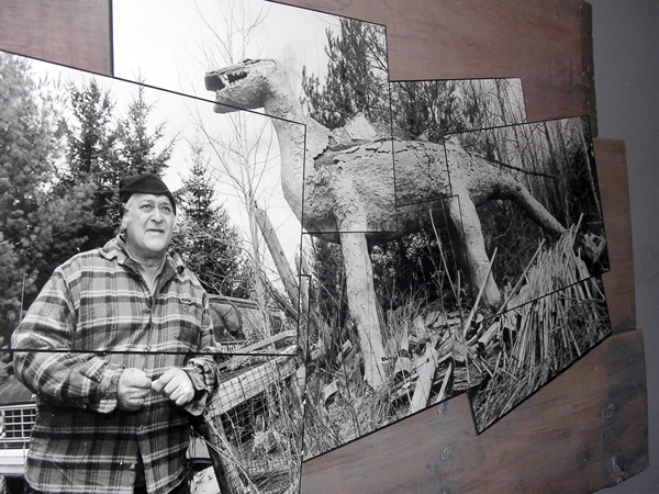 Jerry Cardone (left) is pictured with one of his dinosaur sculptures in a photo taken by Portland photographer Tonee Harbert.