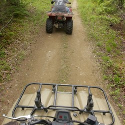 ATV riders travel private trails in the Hermon area last year. The House on Friday voted on a bill seeking to bolster private landowners' protections from all-terrain vehicle users.