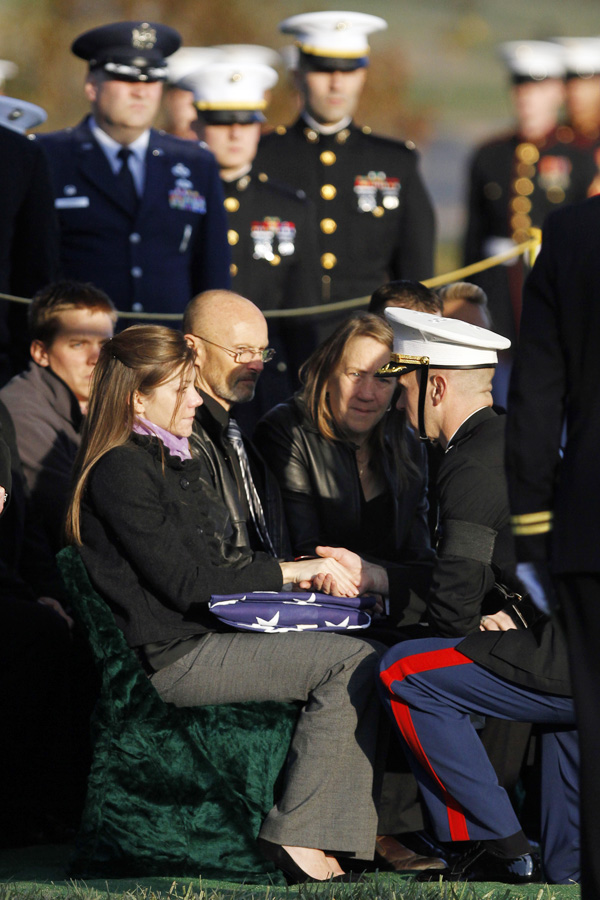 The flag is presented to widow Lynel Winters, left, by Marine Lt. Col. Timothy Sheyda, at the burial service for Marine 1st Lt. James R. Zimmerman, 25, of Maine, who was killed while serving in Afghanistan, at Arlington National Cemetery in Arlington, Va., in Nov. 2010. Next to Winters are Zimmerman's parents, Russell Zimmerman, center, and Jane Zimmerman.