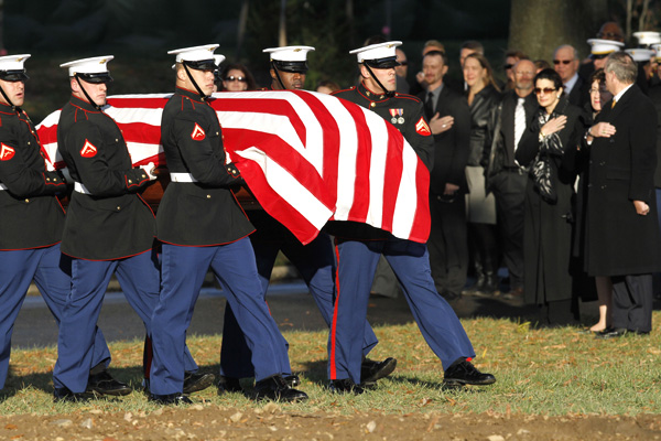 Marines carry the flag covered casket of Marine 1st Lt. James R. Zimmerman, to his burial service at Arlington National Cemetery in Arlington, Va., in Nov. 2010.