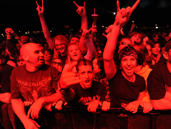 Avalanche concertgoers rock out during the Avalanche Concert on the Bangor Waterfront on Saturday.