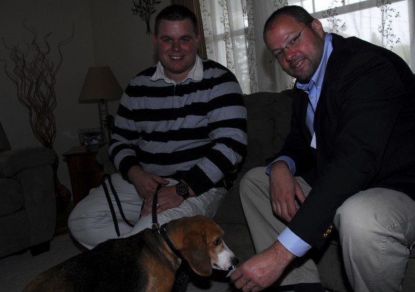 Sherlock the beagle sniffs a vial of the pests with his handler, Anthony Silva, left, and Richard Stevenson, chief technical officer of Modern Pest Services, right, after doing some training at a home in Westbrook on May 16, 2011.