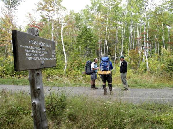 Baxter State Park director Jensen Bissell (right) talks with two hikers from Massachusetts who were crossing a road in the Scientific Forest Management Area  of Baxter State park in 2009.