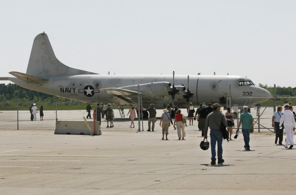 Visitors look at a P3 Orion that returned to the Brunswick Naval Air Station on Tuesday, May 31, 2011, for a ceremony marking the official closure of the base in Brunswick.The Base Closure and Realignment Commission voted to close the base in 2005.