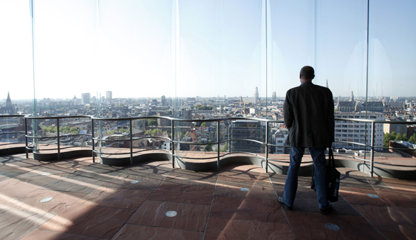 A visitor looks at a view of the city from the inside of the MAS Museum in Antwerp, Belgium.
