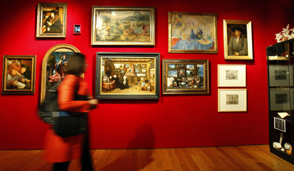 A visitor walks by artwork in the 'Room of Wonders' at the MAS Museum in Antwerp.
