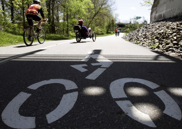 Bikers make their way along a bike path in Brunswick, Maine on Wednesday. The state of Maine was declared the second most bike-friendly state in the nation. The League of American Bicyclists says the ratings are based on a 95-question survey across six categories that include legislation, infrastructure and enforcement.