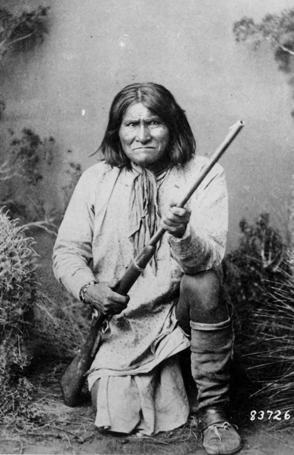 "The famed Indian warrior Geronimo, a Chiricahua Apache, poses with a rifle in 1887. The leader of the Fort Sill Apache Tribe is looking for a formal apology from President Barack Obama for the government's use of the code name ""Geronimo"" for Osama bin Laden."