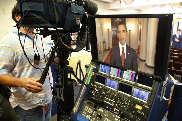 President Barack Obama is seen on a television monitor in the press briefing room as he makes a televised statement on the death of Osama bin Laden from the East Room of the White House in Washington, Sunday, May 1, 2011.